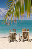 Beach chairs on white sand with blue sky Stock Photo
