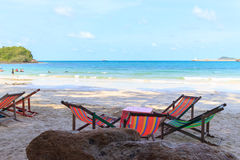 Beach chairs. On the white sand beach with cloudy blue sky royalty free stock photos