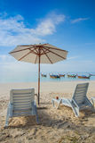 Beach chairs with white umbrella Royalty Free Stock Photo