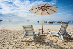 Beach chairs with white umbrella Stock Photo