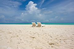 Beach chairs on wide beach Royalty Free Stock Image