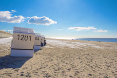 Beach chairs in winter royalty free stock photography