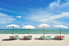 Beach Chairs With Umbrellas Stock Image