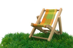 Beach chaise. And grass on white background royalty free stock photography