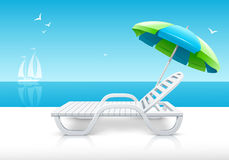 Beach chaise longue with umbrella on sea coast Royalty Free Stock Photography