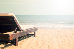 Beach with chaise lounge. Beautiful beach with chaise lounge. Sea background with copy space. tonned stock photos