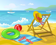 Beach with chaise lounge and recreation items Royalty Free Stock Images