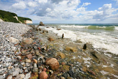 Beach and chalk cliffs on the German island Ruegen. Pebble beach and chalk cliffs on the German island Ruegen stock image