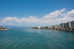 Beach of Chalkis, Greece. Distant view of Chalkis' beach on a nice sunny day. Chalkis is famous for the irregular flow of the waters Stock Images