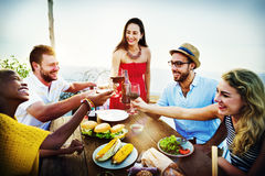 Beach Cheers Celebration Friendship Summer Fun Dinner Concept.  Stock Image
