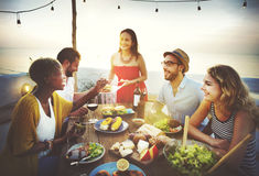 Beach Cheers Celebration Friendship Summer Fun Dinner Concept.  Royalty Free Stock Image