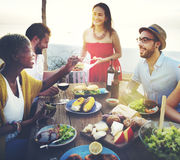 Beach Cheers Celebration Friendship Summer Fun Dinner Concept.  Stock Photography