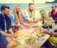 Beach Cheers Celebration Friendship Summer Fun Dinner Concept.  Stock Images