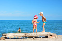 Beach children play summer vacations. Beach children play swimming costume summer vacations royalty free stock photos