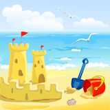 Beach with childrens toys and sandcastles Royalty Free Stock Photography