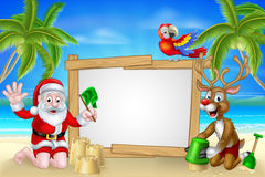 Beach Christmas Santa and Reindeer Royalty Free Stock Photo