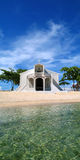 Beach Church in Philippines. White church on white sandy beach in Philippines Stock Photo