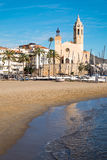 Beach and church in Sitges Royalty Free Stock Image