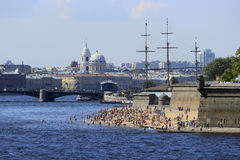Beach in the city center of St.Petersburg, Russia. People are swimming during the hot day in August in the center of Saint-Petersburg, Russia. Swimming is Royalty Free Stock Image