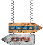 Beach and City - Directional Signs. Wooden directional sign with two arrows in opposite direction hanging with metal chain, with text beach and city. Isolated on Stock Image