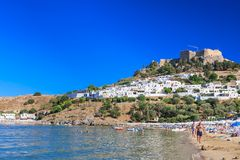 Beach in the city of Lindos. Rhodes Island. Greece Stock Photos