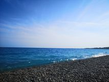 Turquoise sea beach in Nice, France, France stock photography