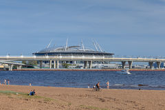 Beach in city park next to road overpass and stadium. Royalty Free Stock Photos