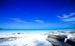 Beach with clear blue skies and blue waters Stock Photos