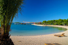 Beach with clear crystal water Stock Photography