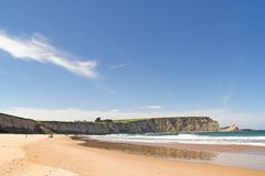 Beach and cliff. Langre, Cantabria, Spain stock photo