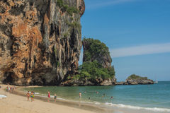 Beach and cliff. Activity on the beach at Andaman sea of Thailand Royalty Free Stock Images