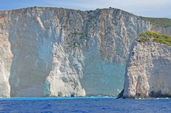 Beach cliff and blue waters Royalty Free Stock Images