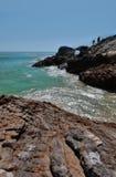 Beach Cliff Hikers in Malibu California. Rocky shore with hikers in Malibu California Royalty Free Stock Photo