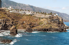 Beach  with cliff. Beach in Tenerife with a cliff houses on a sunny day Royalty Free Stock Photos
