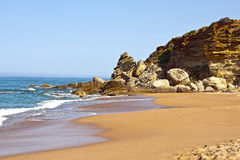 Beach and cliffs on the Atlantic coast near Cadiz, Royalty Free Stock Image