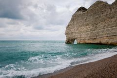 The beach and cliffs of Etretat, the Normandy tourist site of the French city Royalty Free Stock Image