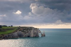 The beach and cliffs of Etretat, the Normandy tourist site of the French city Stock Photo