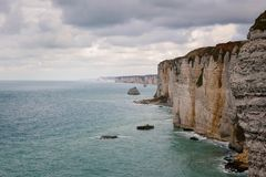 The beach and cliffs of Etretat, the Normandy tourist site of the French city Royalty Free Stock Photography