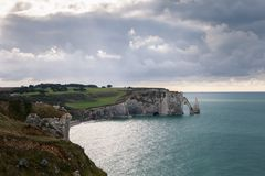 The beach and cliffs of Etretat, the Normandy tourist site of the French city Royalty Free Stock Photo