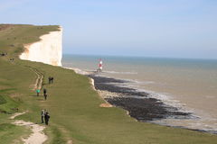 Beach cliffs scenic views. A stunning view across the English Channel from above Beachy Head in Sussex with the lighthouse at the foot of the white cliffs Stock Photo