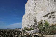 Beach cliffs scenic views. A stunning view across an English Channel beach in Sussex with high white cliffs and blue sky and the Seven Sisters landmark in the Royalty Free Stock Image