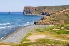 Beach, cliffs, trail and mountain in Canal beach Royalty Free Stock Photo