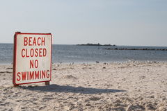 Beach closed. A white sand beach in Florida is closed due to chemical pollution of the water Stock Photos