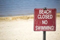 beach closed no swimming sign Stock Photos