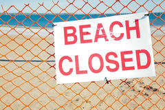 Beach Closed Sign. Sign posted to let beach-goers know that the beach is closed Stock Photos