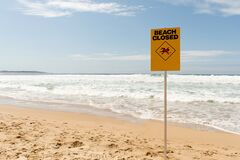 Free Beach Closed Sign Standing Near The Ocean Stock Images - 195413774