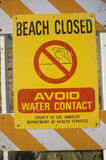 A beach closed warning sign Stock Photo
