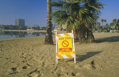 A beach closed warning sign Stock Image