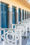 Beach closets with famous names in Deauville, France. FRANCE, DEAUVILLE - SEPTEMBER 27: original beach closets with famous names on promenade Des Planches in royalty free stock image
