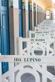 Beach closets with famous names in Deauville, France. FRANCE, DEAUVILLE - SEPTEMBER 27: original beach closets with famous names on promenade Des Planches in stock photography
